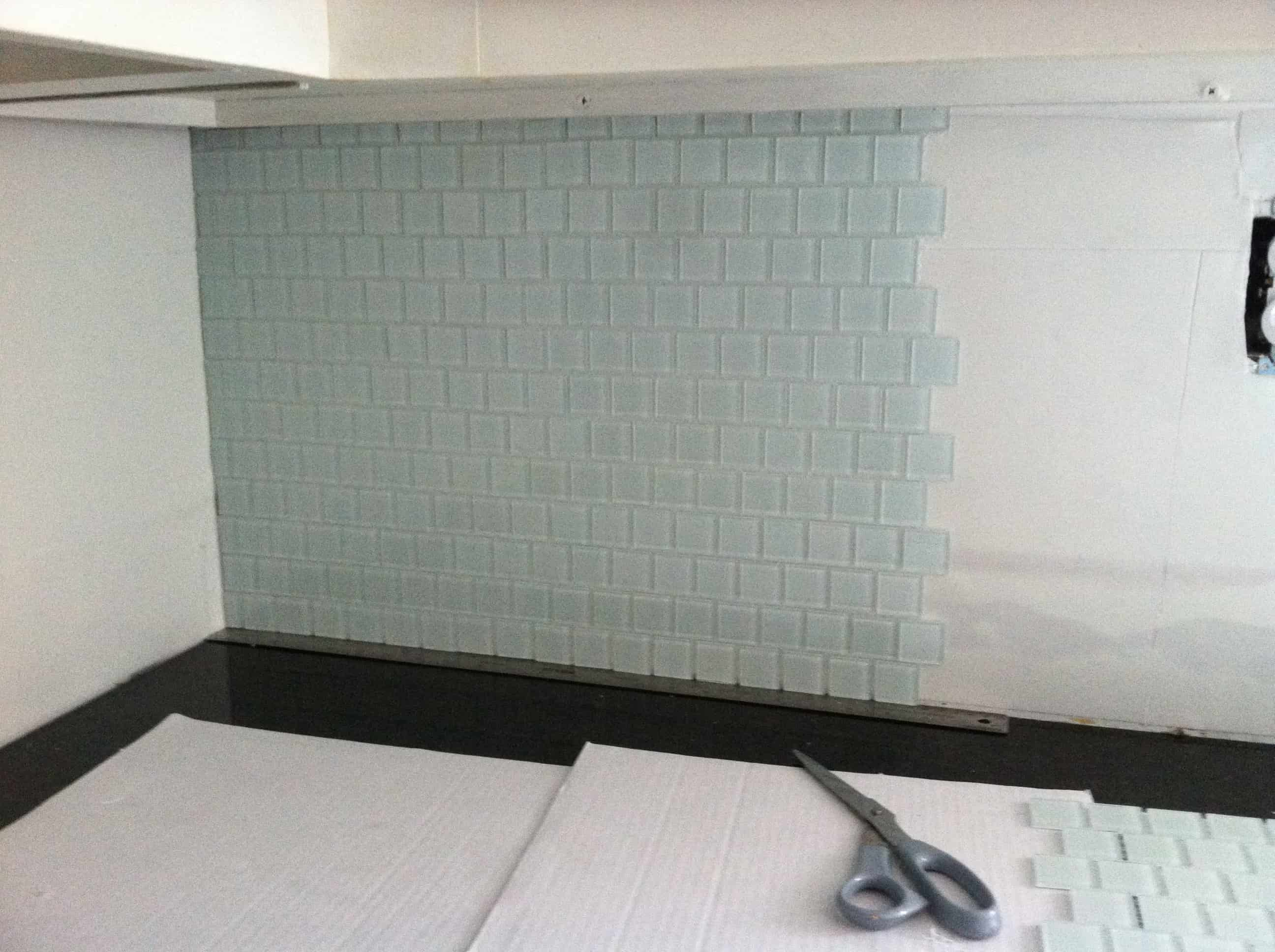 Musselbound Tile Mat Review- Sheets of Musselbound Tile applied to the wall with sheets of glass tile pressed on to them