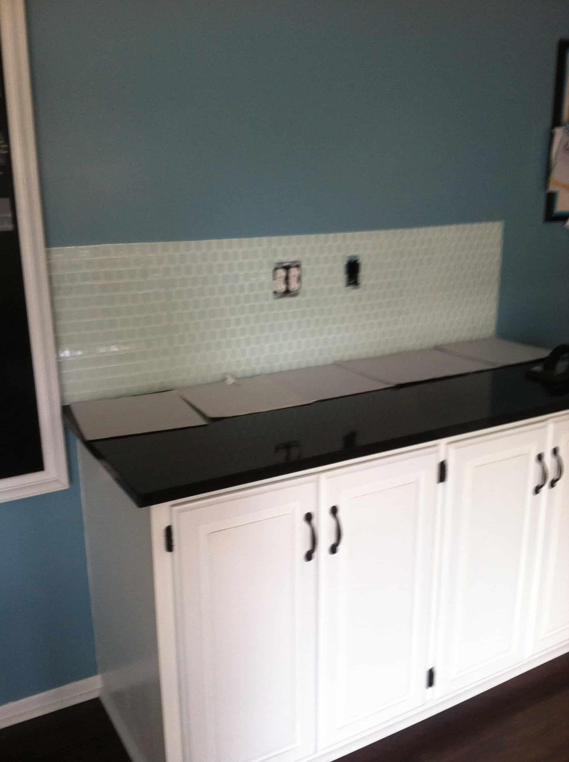 area of cabinets where basksplash tile has been installed using Musselbound Tile Mat Sheets
