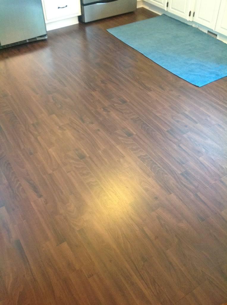 updated dark brown laminate flooring in the kitchen