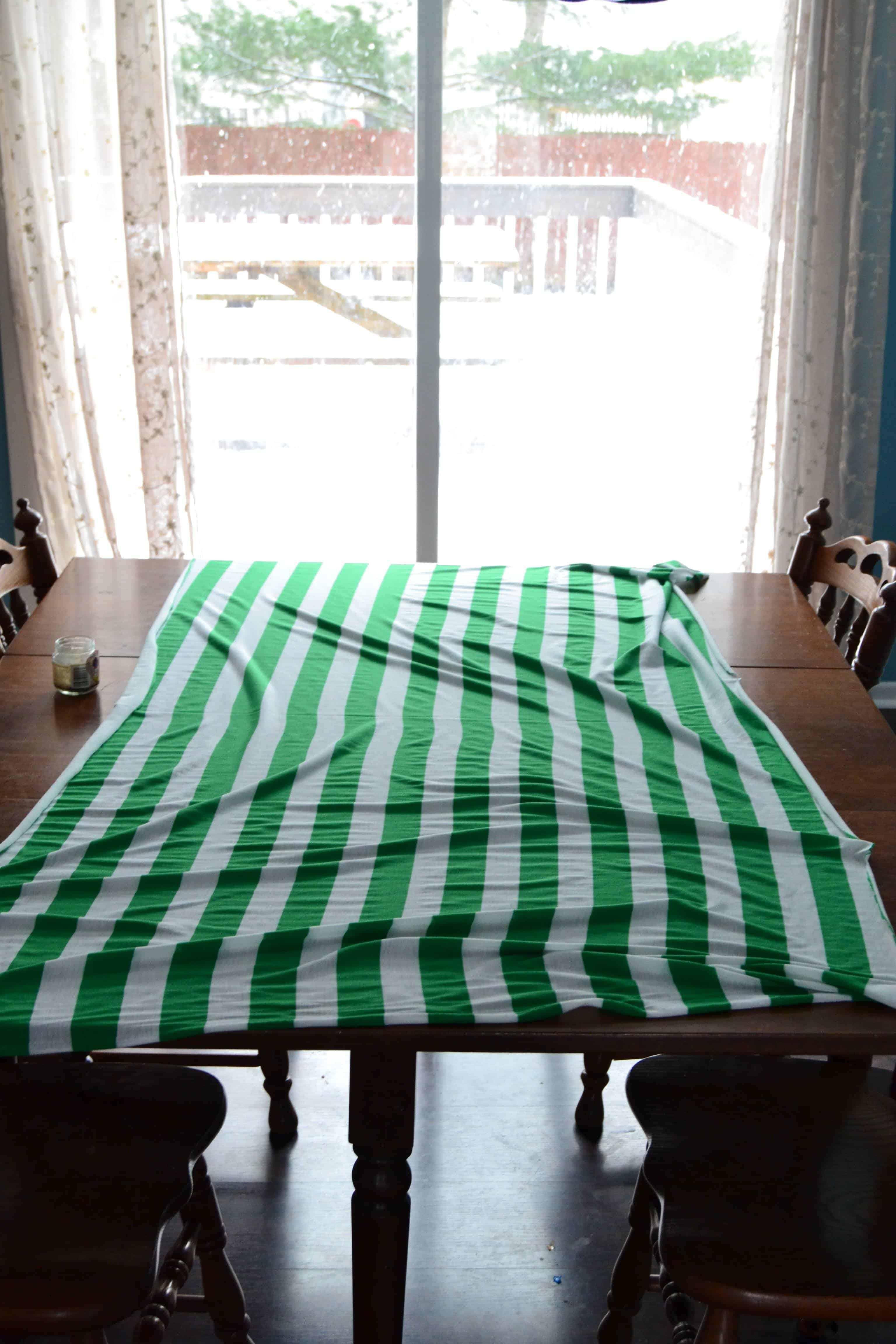1 yard of striped knit fabric laid out on a table