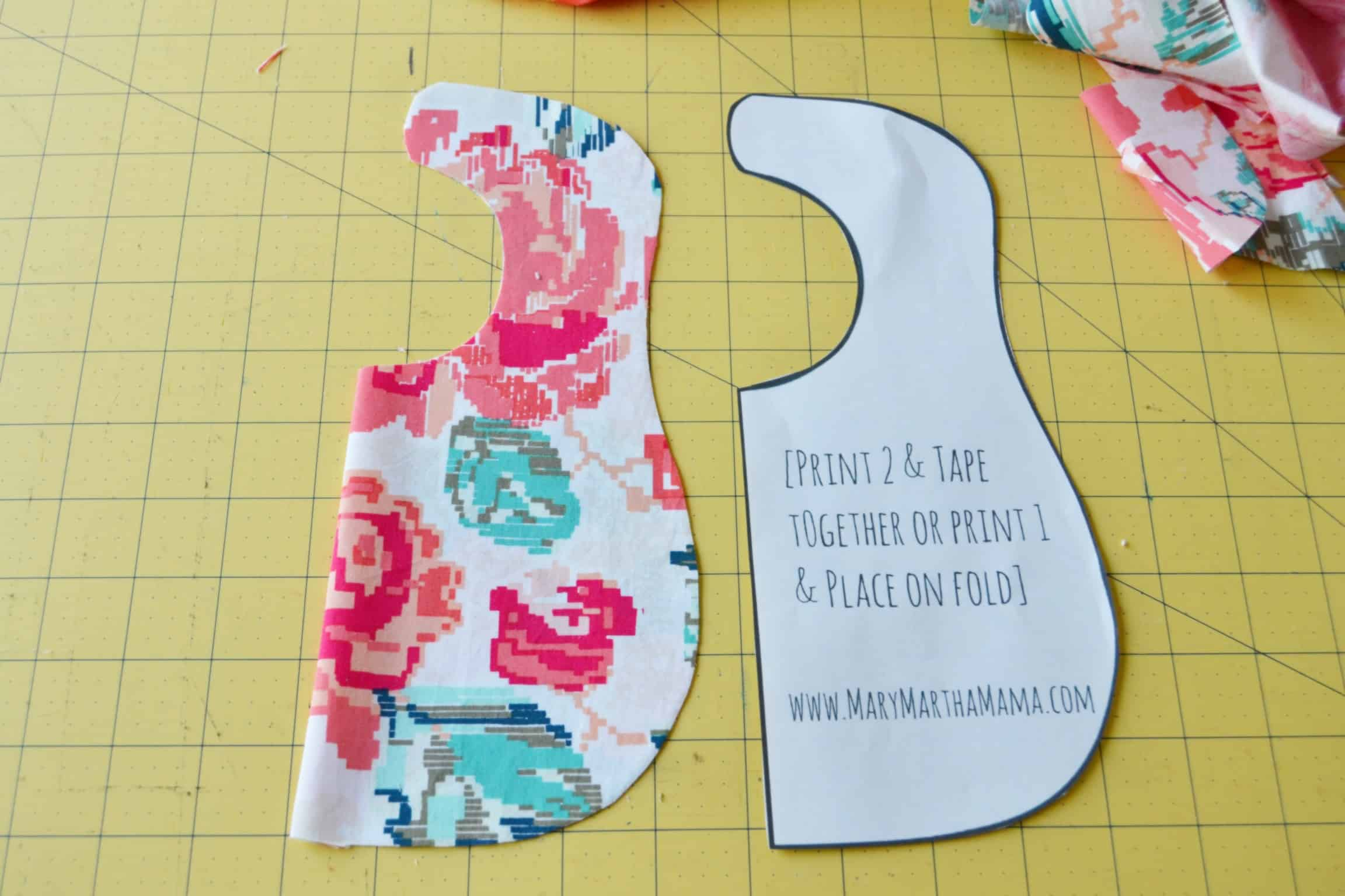 the bib once it is cut out sitting next to the pattern piece