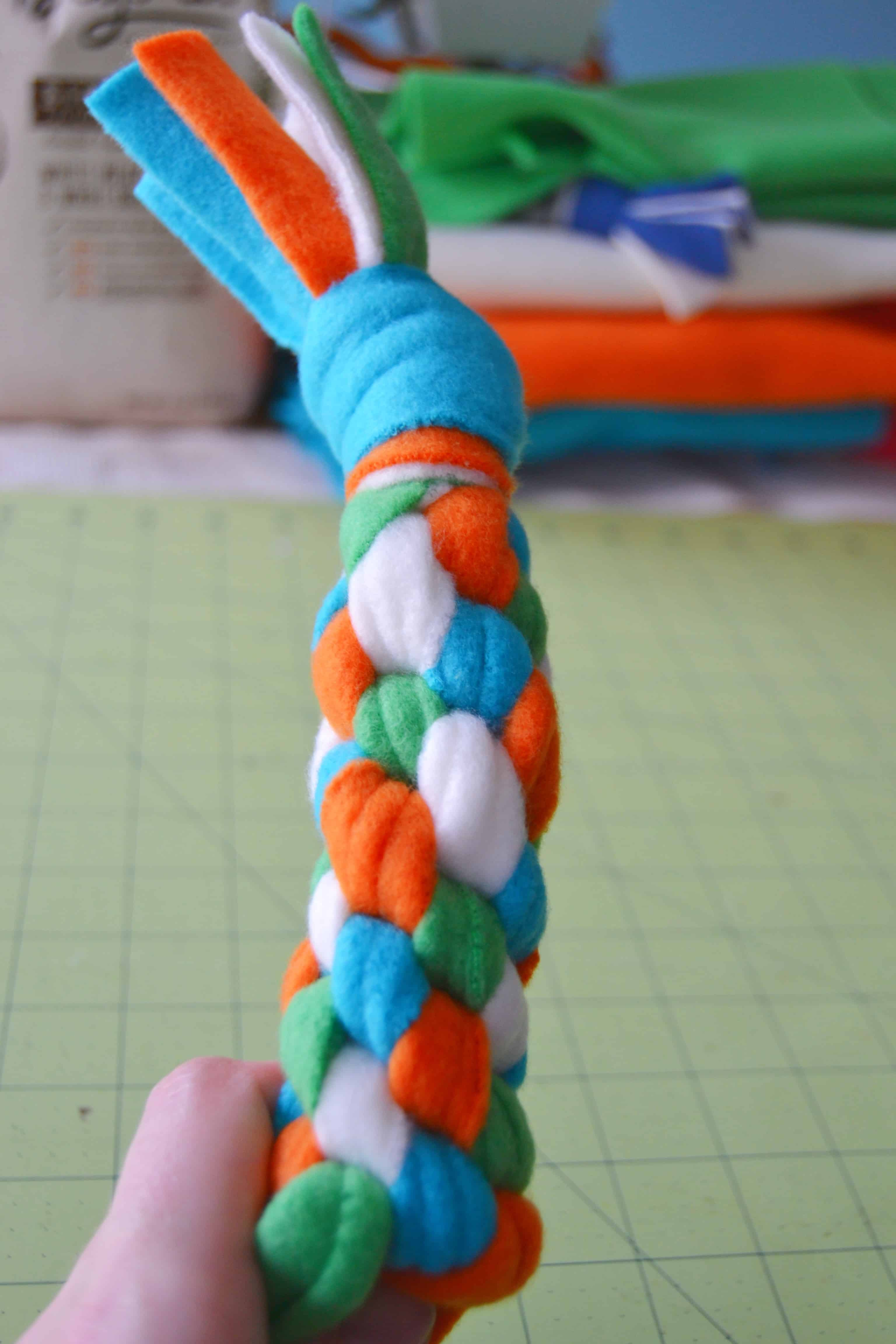 the fleece dog toy mostly finished after repeating the knotting process