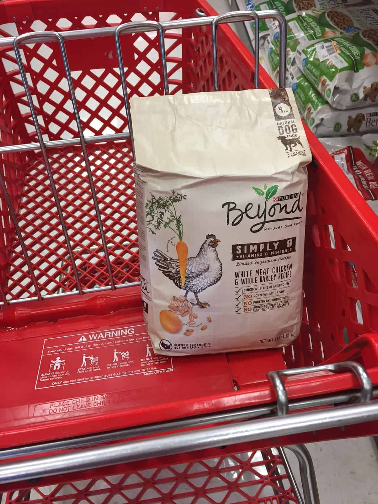 a bag of dog food in a grocery cart
