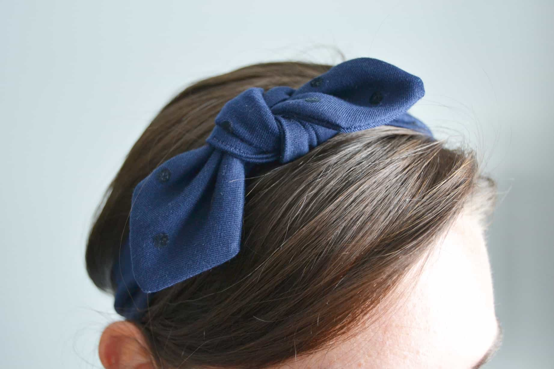 DIY knotted headband on a brunette