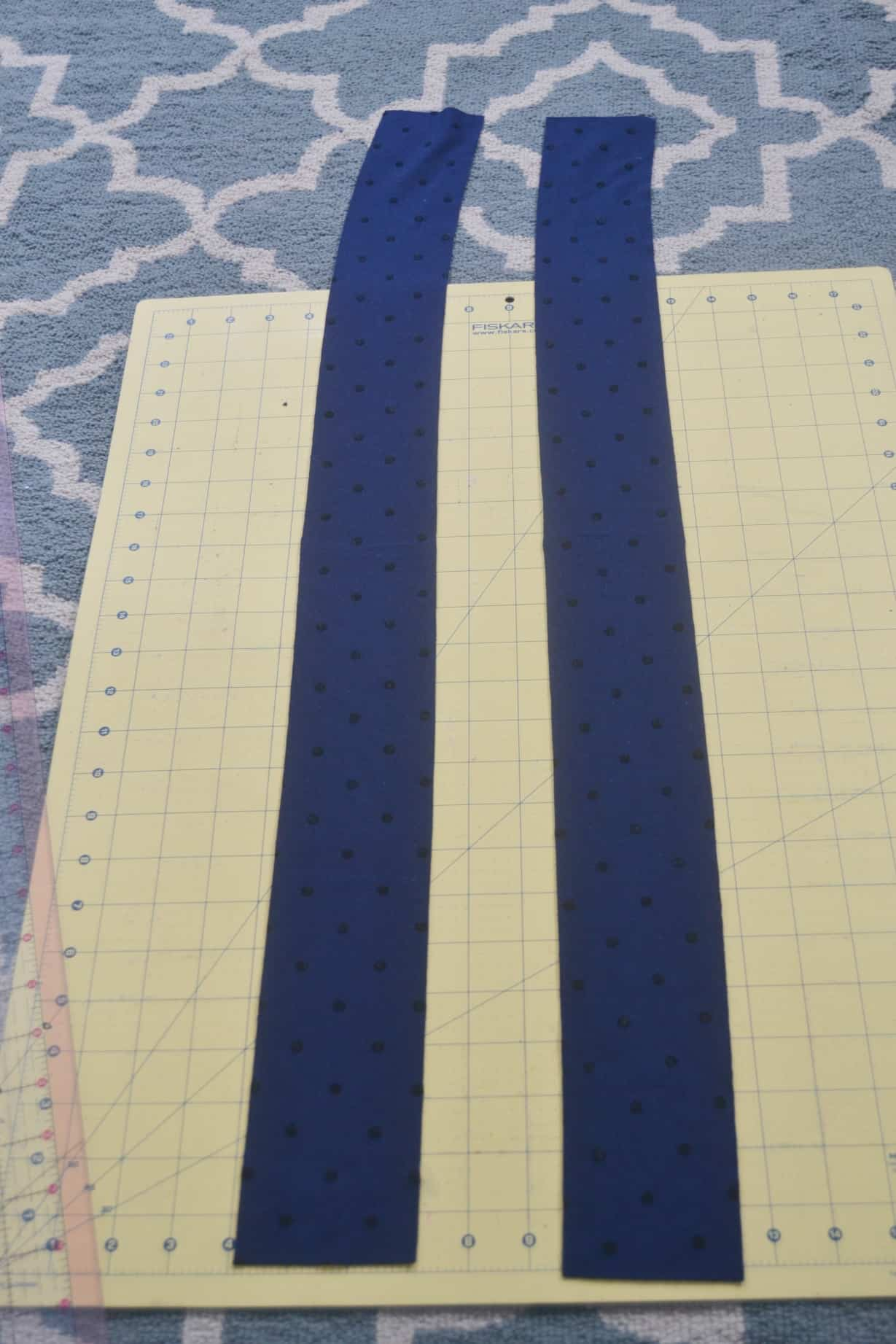 The two fabric rectangles cut out to make the diy knotted headband
