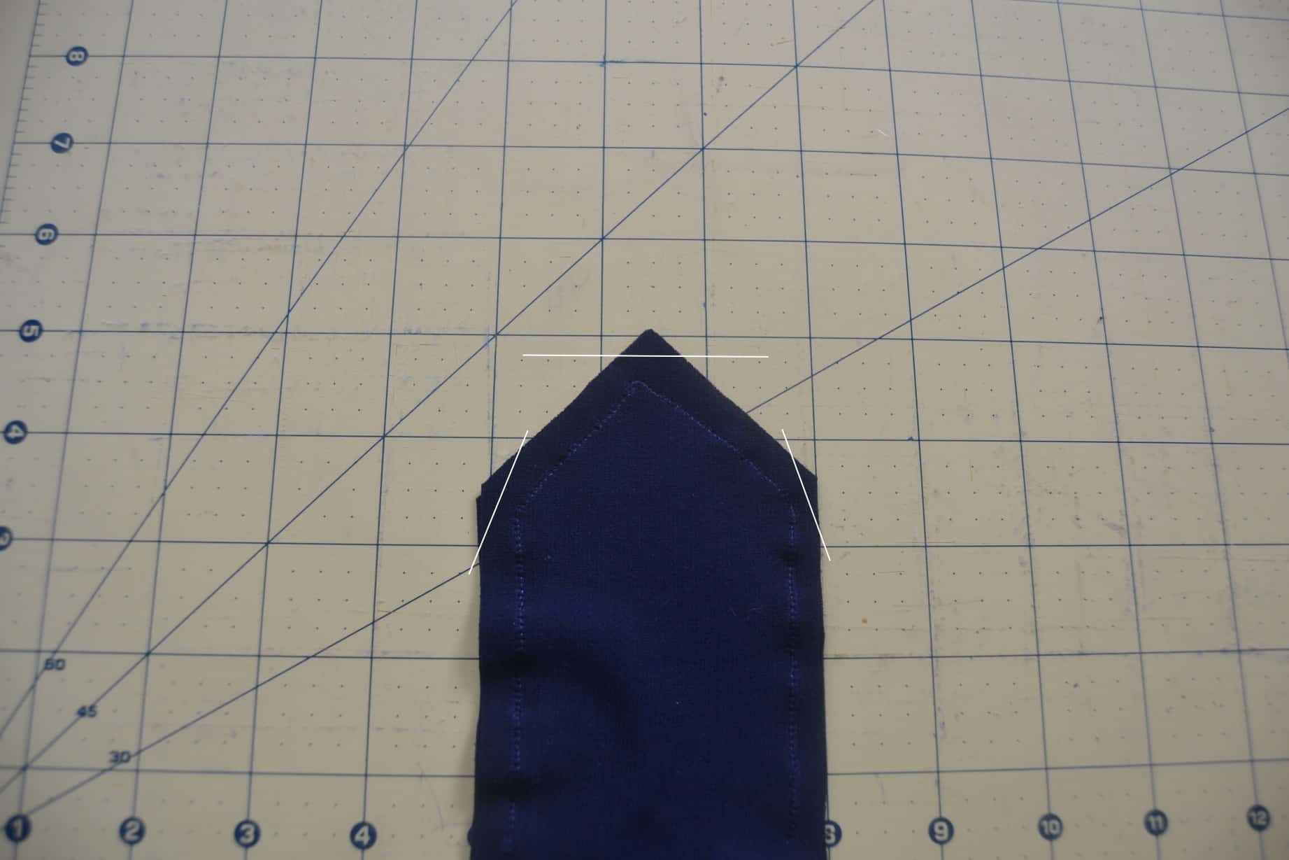 lines drawn across the end of the points to show how to trim down the excess fabric at the corners