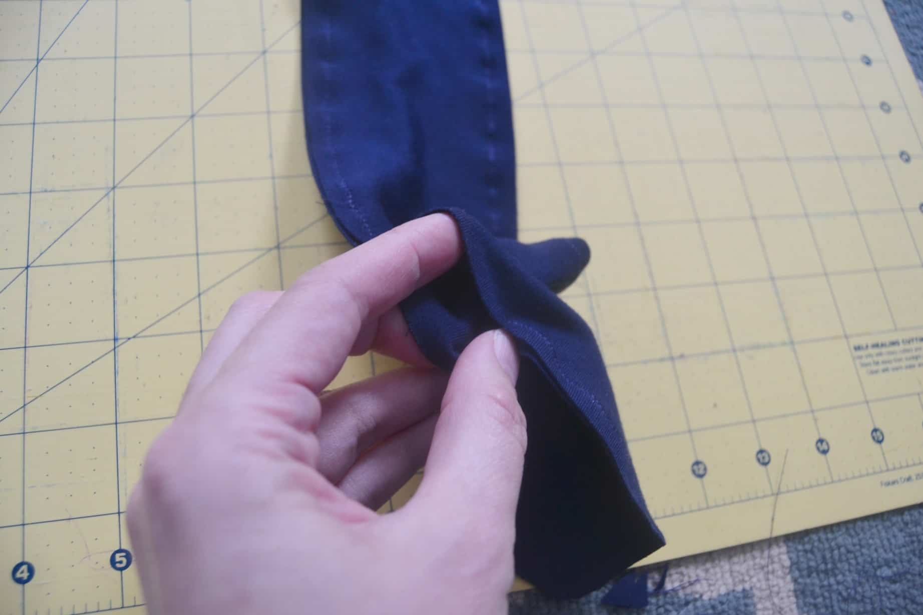 the opening needed to turn the diy knotted headband right side out