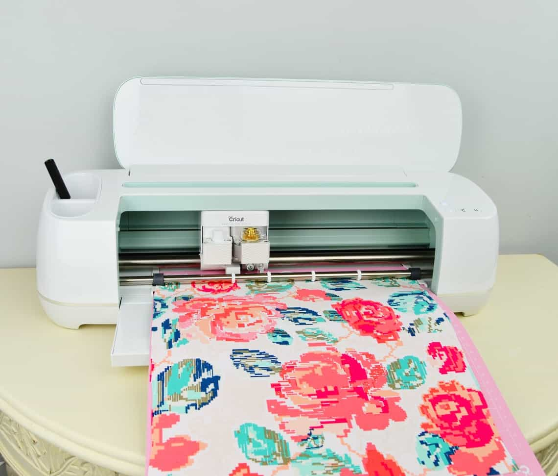 The Cricut Maker cutting out fabric.