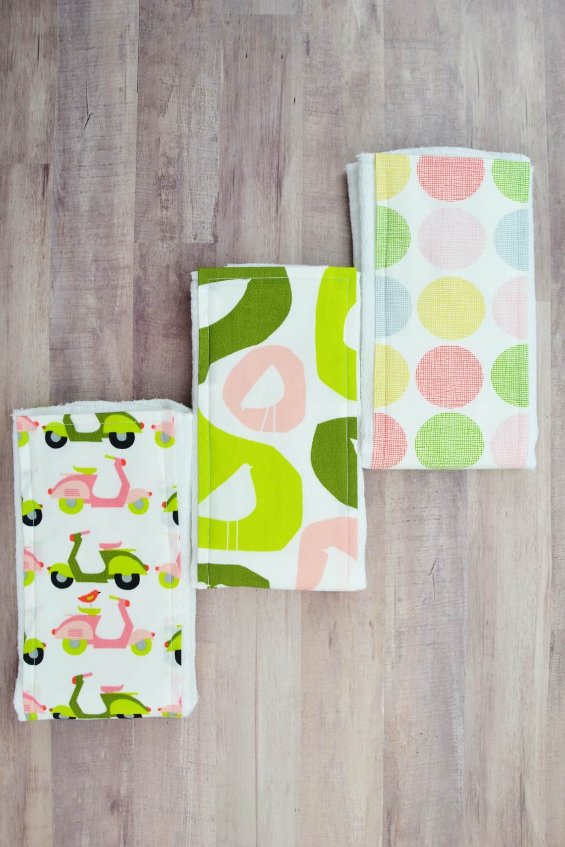 How to Make a Burp Cloth from a Diaper- Follow this tutorial for how to make a burp cloth very quickly by adorning a cloth diaper. #howtomakeaburpcloth #diyburpcloth