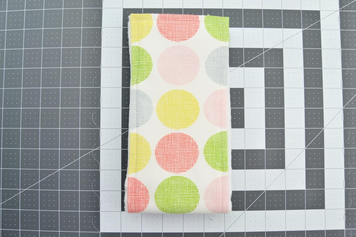 the burp cloth then folded in half