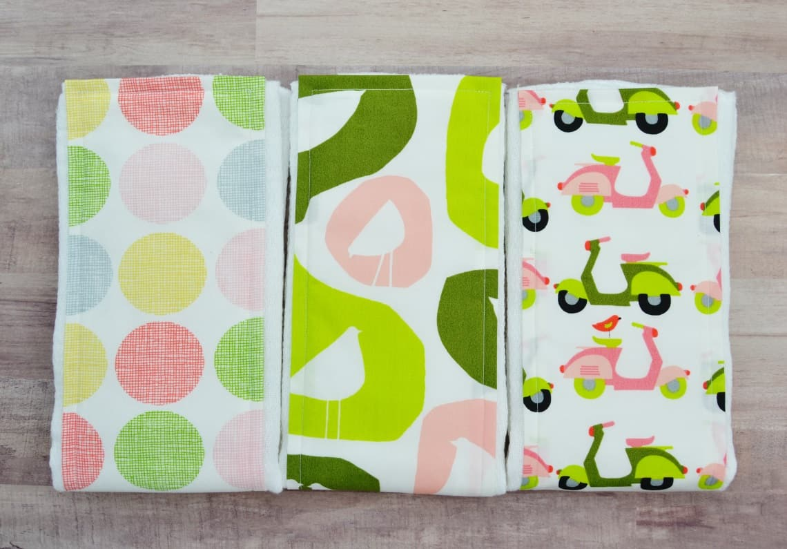 a set of three coordinating burp cloths