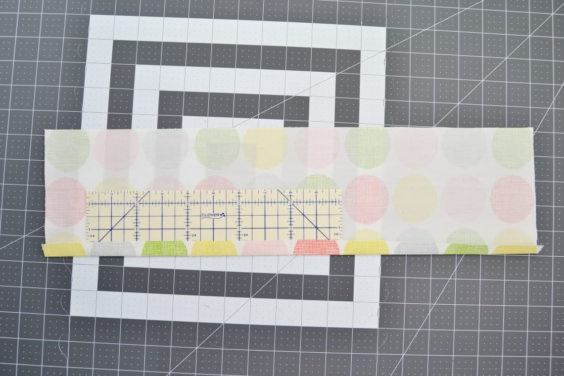 using the hemming ruler to press each side over half an inch
