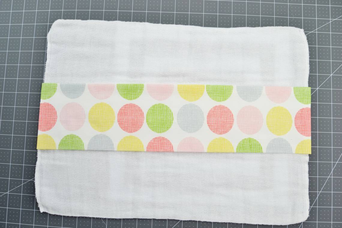 the cotton fabric rectangle once it's been pressed and is centered on top of the cloth diaper