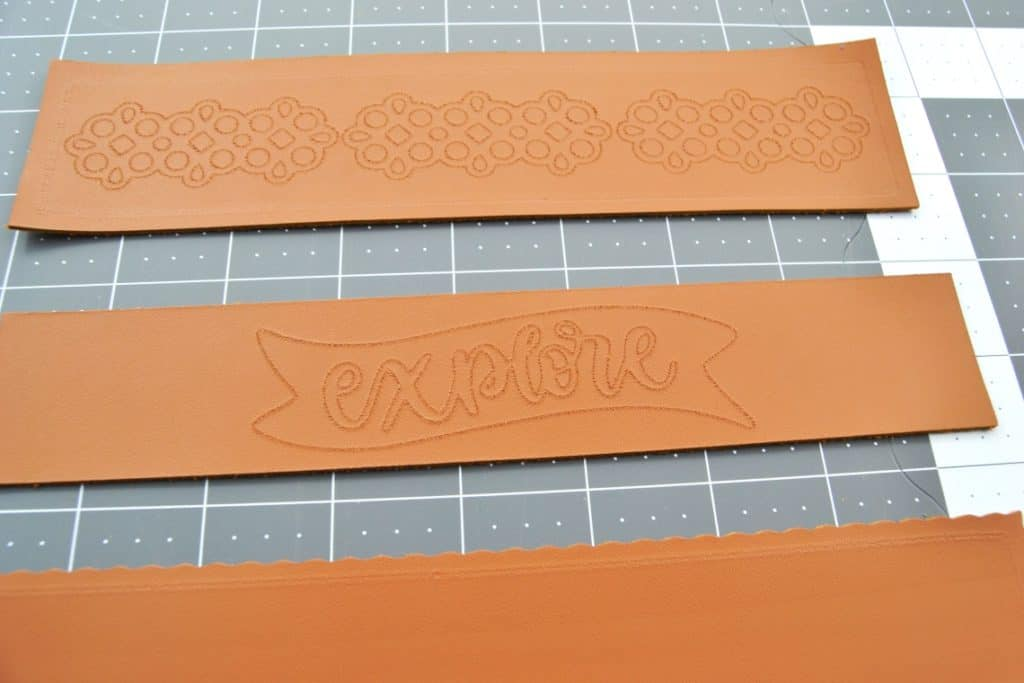 the leather cuffs once they have been cut out and are laying on a gray background