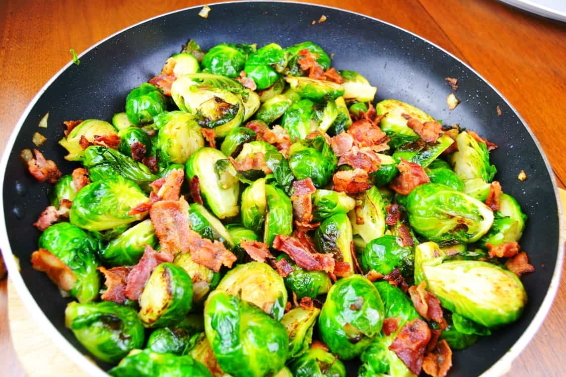 Pan Roasted Brussels sprouts in the pan fully cooked with the bacon added in