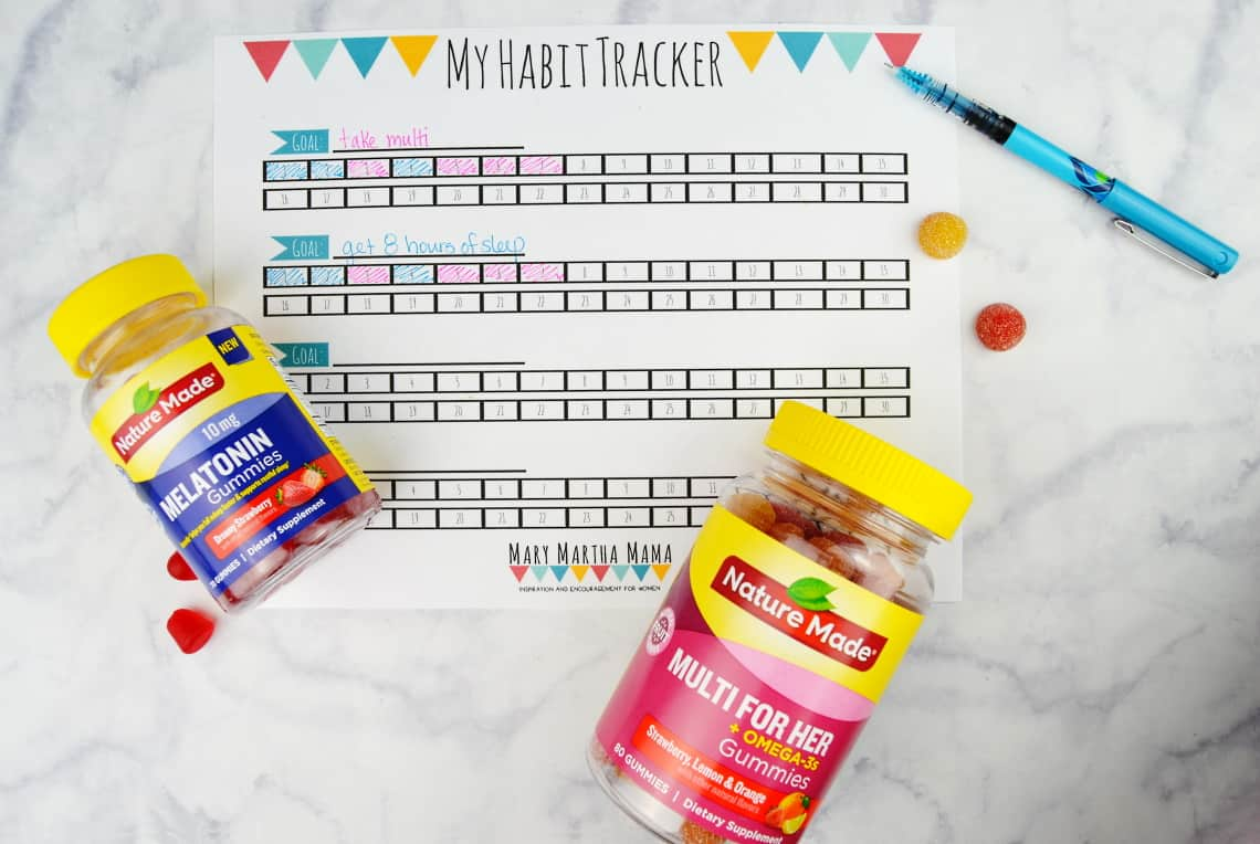 free printable habit tracker with the supplements and a pen