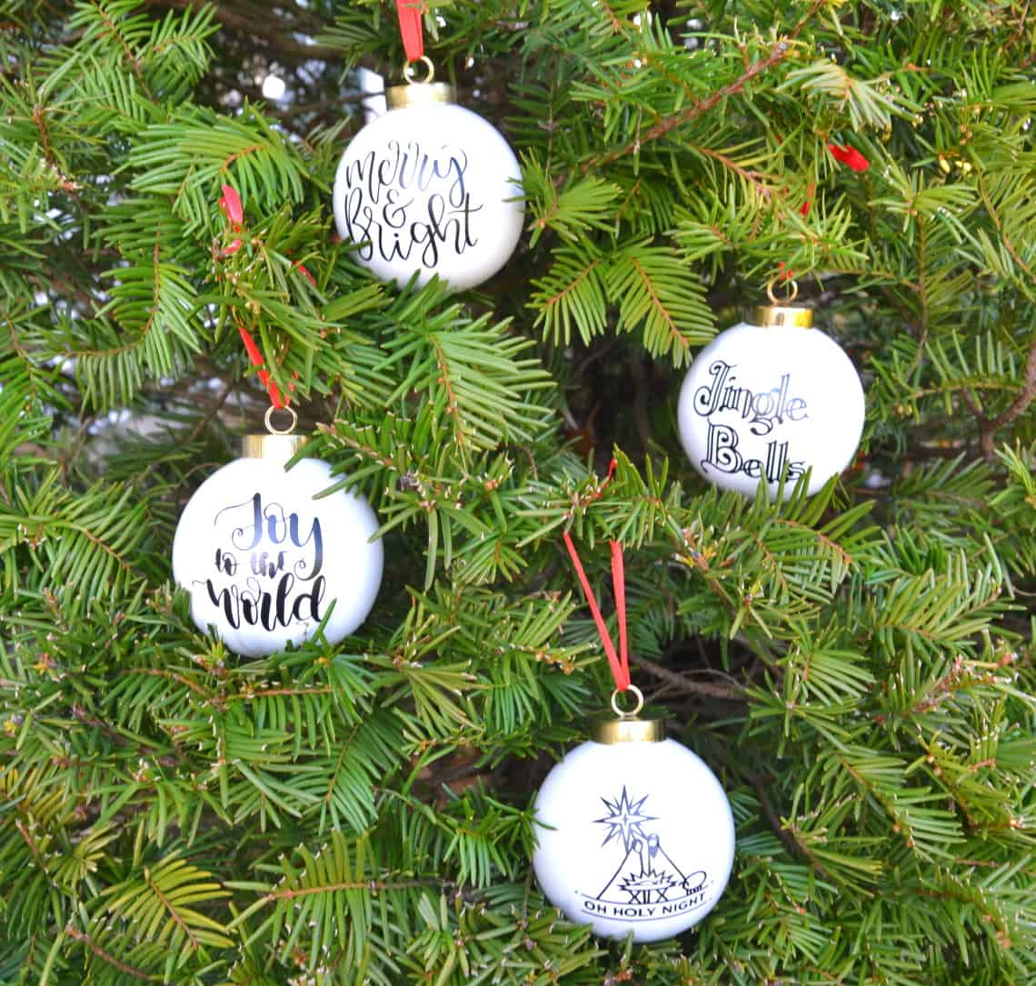 making christmas ornaments with cricut- 4 different ornaments decorated with vinyl cut by cricut maker