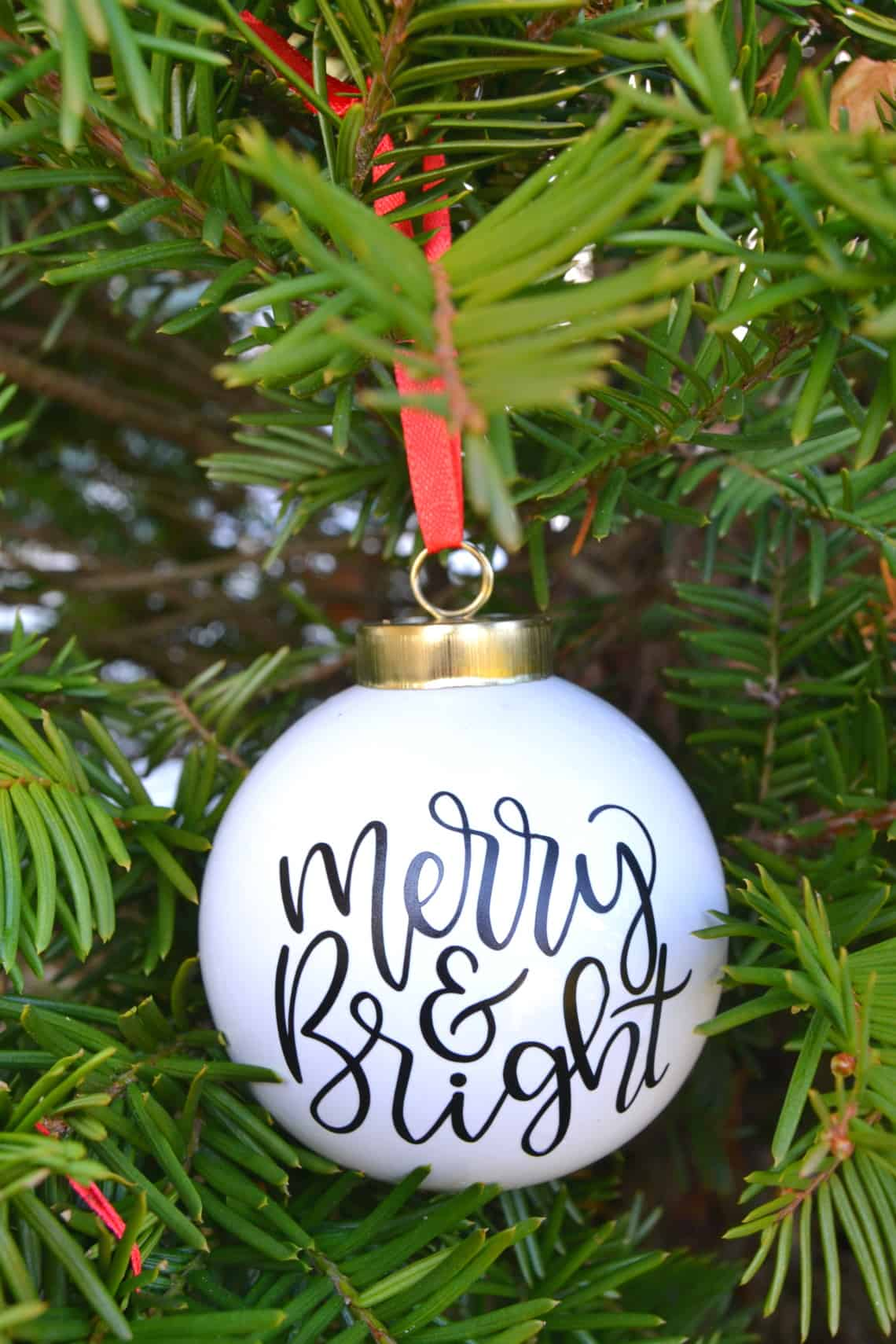 Making Christmas ornaments with cricut finished ornament hanging in a Christmas tree