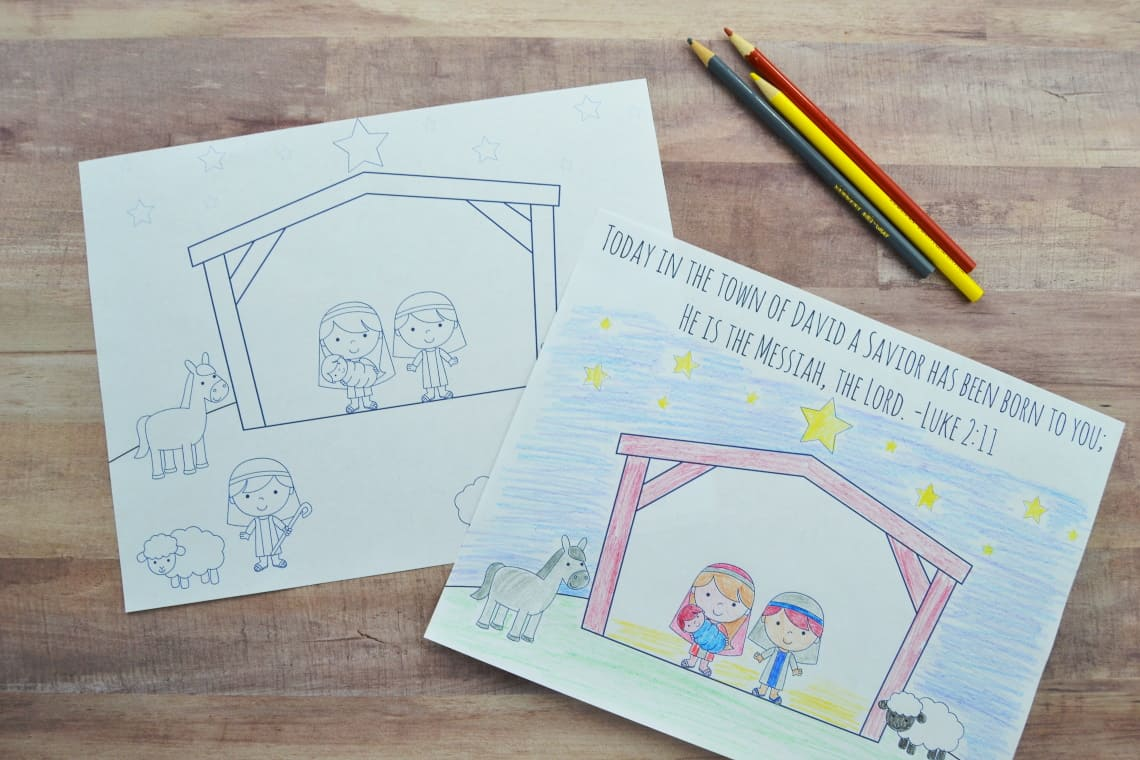 Nativity coloring pages sitting on the table with some colored pencils