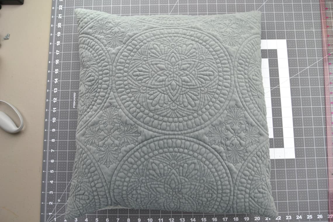 the pillow cover completed and with a pillow form inside