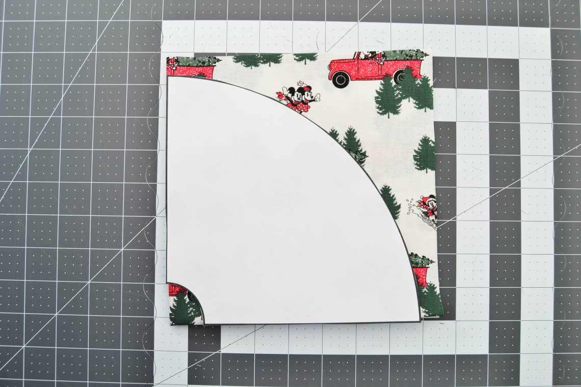 the mini tree skirt pattern printed out and on top of the folded square of fabric