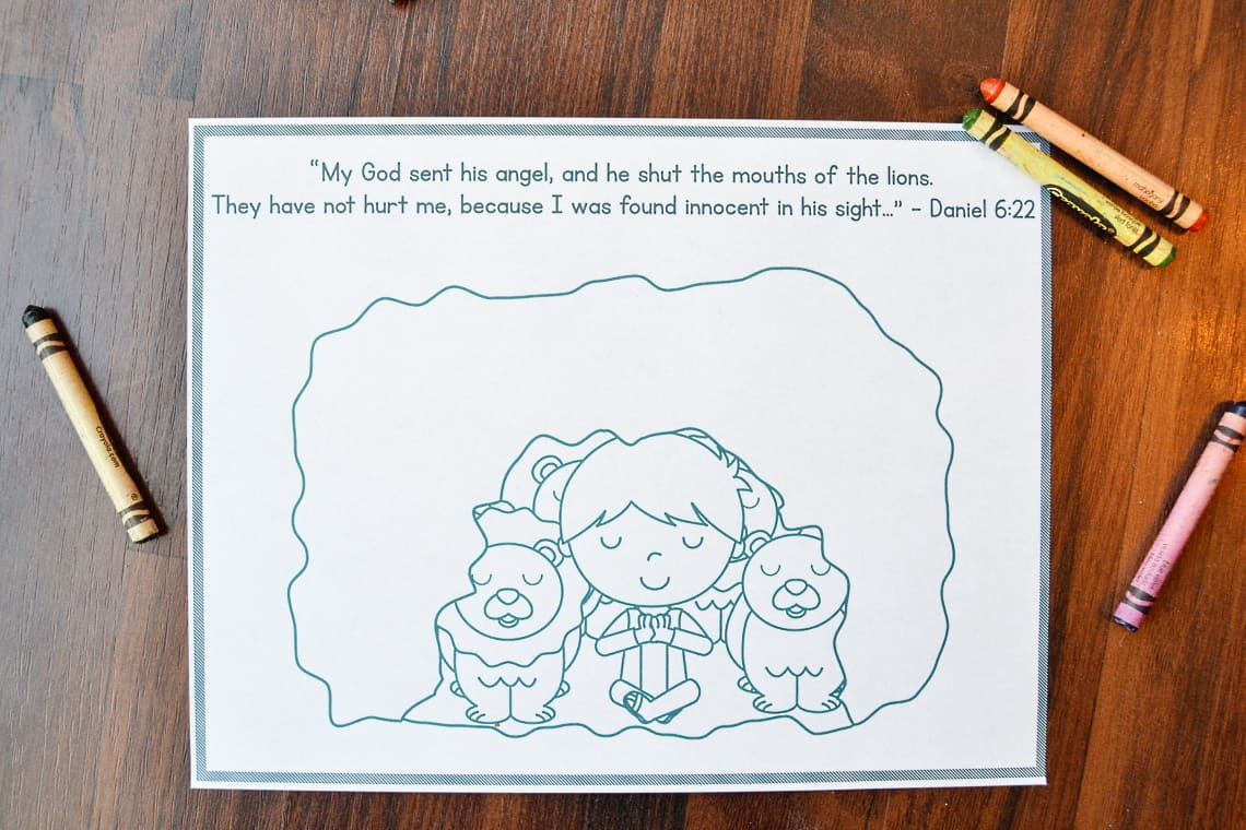 Daniel and the Lions' Den Coloring Page printed out with crayons