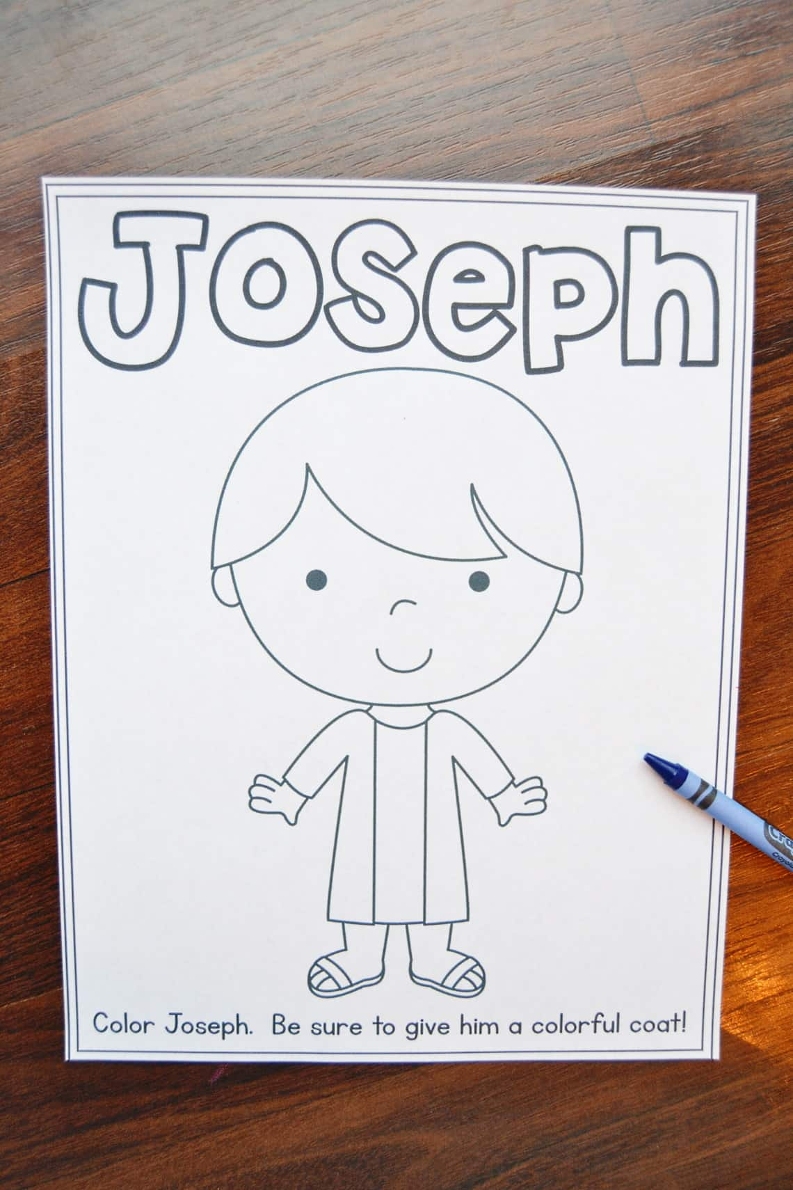 Joseph coloring page with crayons