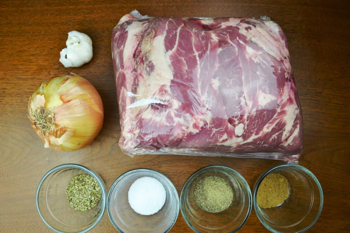 slow cooker carnitas recipe ingredients sitting on a table