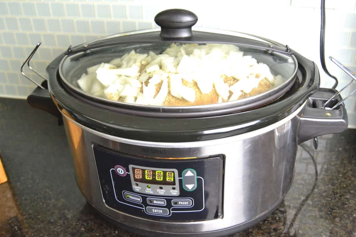 slow cooker carnitas cooking in the slow cooker