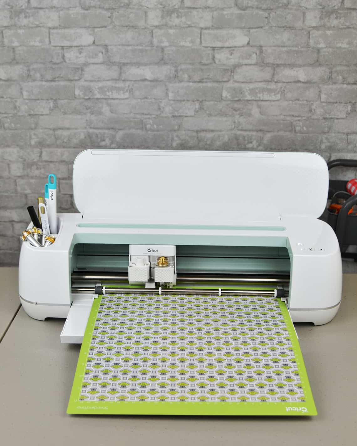 Cricut Maker with vinyl loaded onto mat