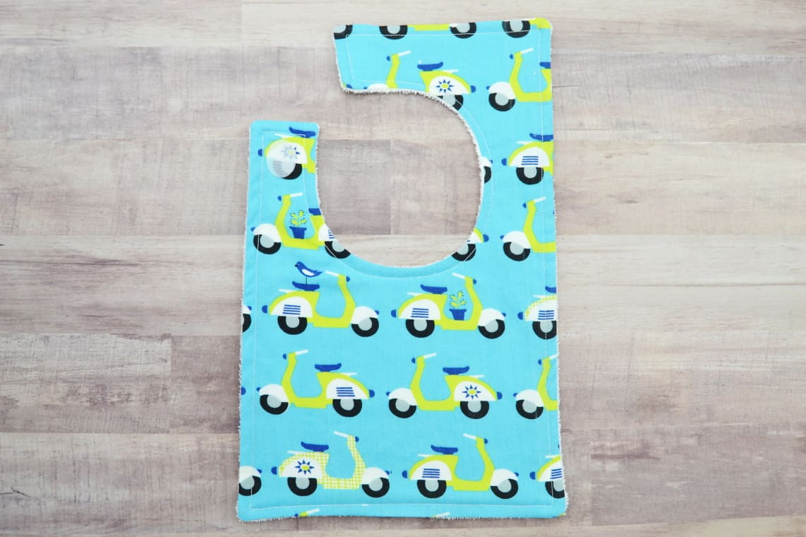 finished bib made with the baby bib pattern for the Cricut Maker