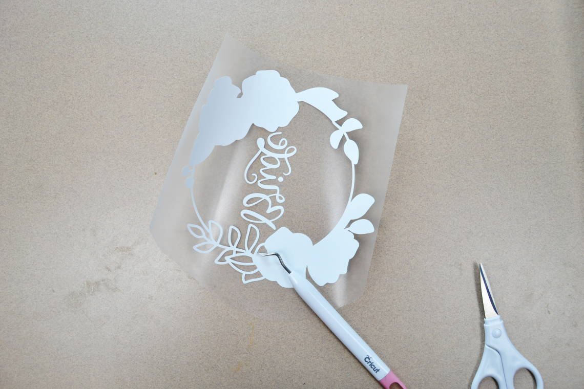 weeding (removing) the vinyl that isn't part of your design