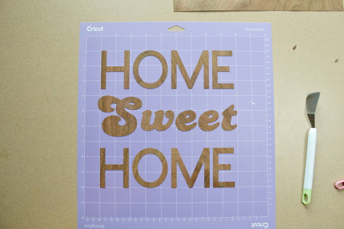 the words home sweet home cut out