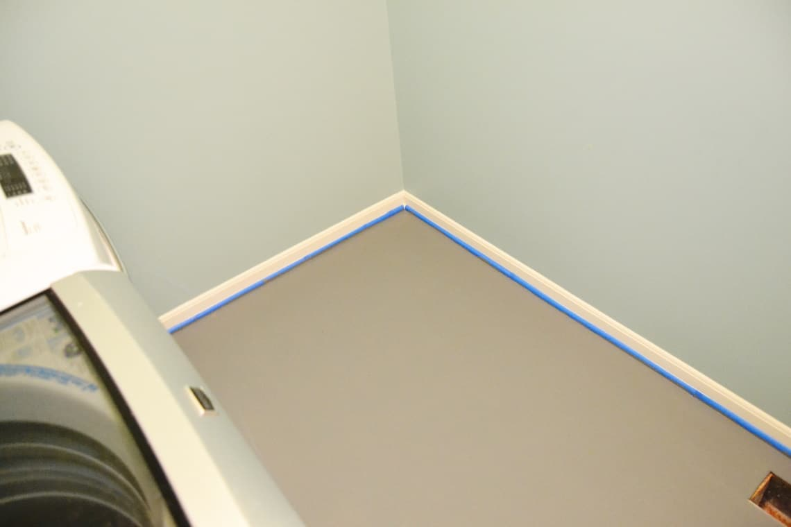 the walls and floor painted in the modern mud room makeover