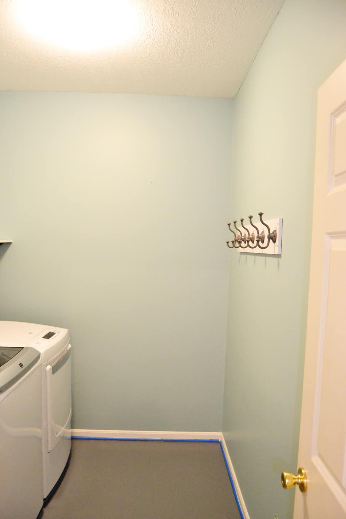 the walls and floor painted as step 1 of the modern mud room makeover