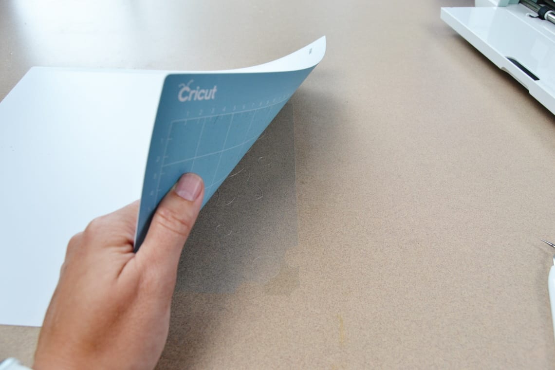 Peeling the cutting mat away from the stencil