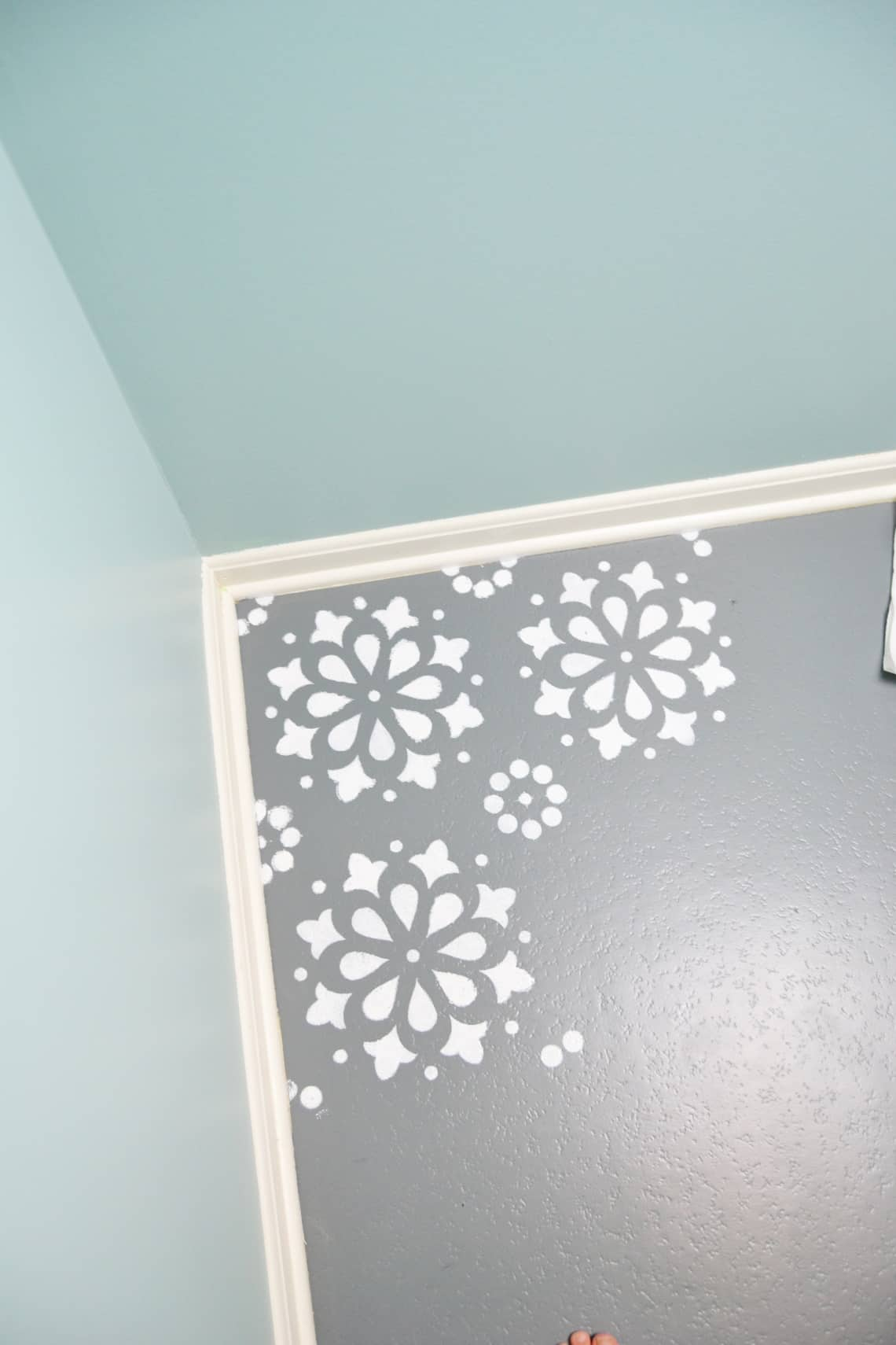 the partially stenciled pattern on the floor