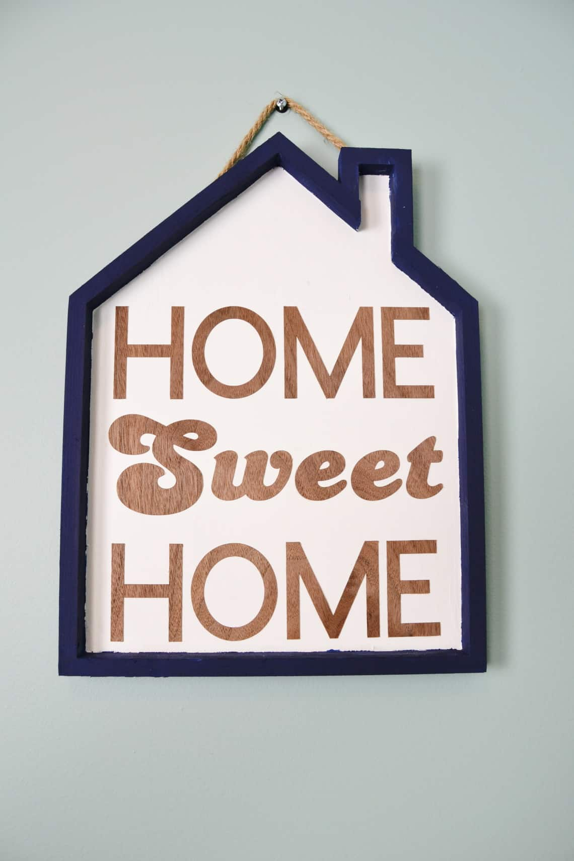 the finished home sweet home sign hanging on the wall